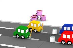 Le macchinine colorate riparano la strada